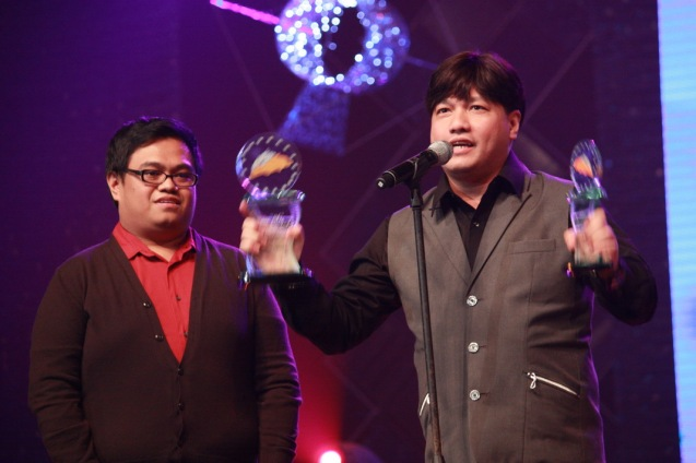 from left: Creative Associate Kriz Gazmen and Director Wenn V. Deramas (Tanging Ina Mo, Last Nato) receive the Best Story and Best Director trophies during the 36th MMFF Awards night at the Meralco Theater. Dec. 26, 2010. Photo by Jude Bautista