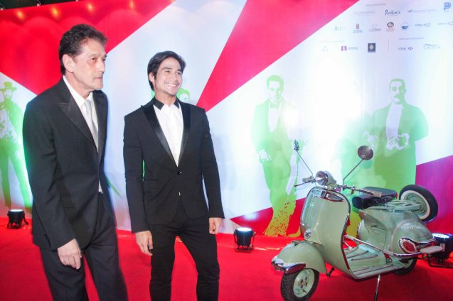 from left: Star Magic Chairman Emeritus Johnny Manahan and Piolo Pascual beside a fully restored Vespa PX150. The Moviemov: Italian Film Fest rolled out the red carpet at the Ayala Museum and GB3 cinema. Photo by Jude Bautista.