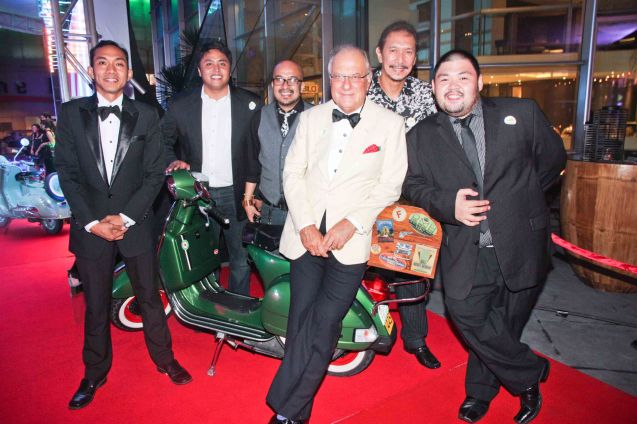 (Center) Italian Ambassador Luca Fornari (white tux) sitting on a fully restored Vespa PX150 with Vespa Club of the Philippines Members L-R Mark Laccay, 2012 Club President Dax Morfe, Patrick Pulumbarit, Cesar Dizon, 2012 Club P.R.O. Jason Tobillo. The Moviemov: Italian Film Fest rolled out the red carpet at the Ayala Museum and GB3 cinema. Photo by Jude Bautista.