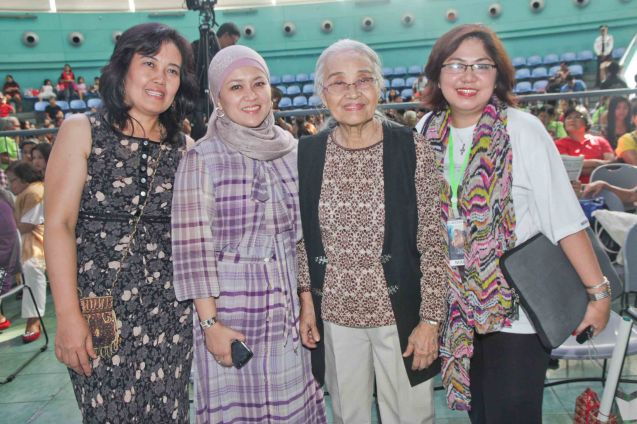 From left: Choy Mendoza, former executive director of National Commission on Muslim Filipinos Sitti Djalia Turabin-Hataman, Rustica Carpio, Marie Jusi Head of Noranian Organizations. Photo was taken during fan's day in SM North EDSA. Photo by Jude Bautista