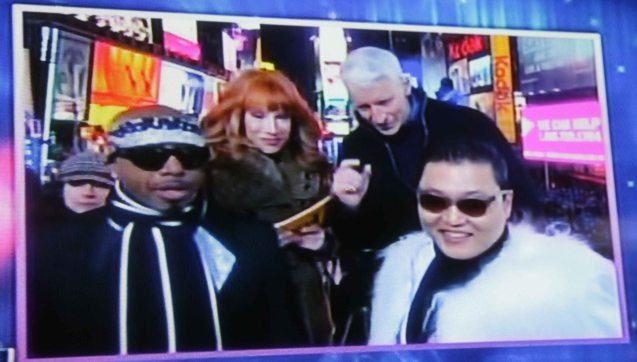 From right: PSY, Anderson Cooper, Kathy Griffin and MC Hammer at the New Year's Eve celebration on Times Square. Anderson tells PSY he was 'this close to wearing the same thing.'