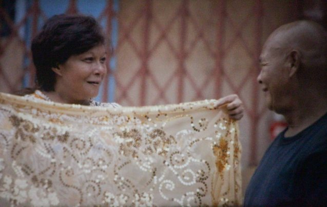 Left: Nora Aunor (Shahela) receives a gift from Bembol Roco (Bangas An) in Brillante Medoza's award winning film THY WOMB.