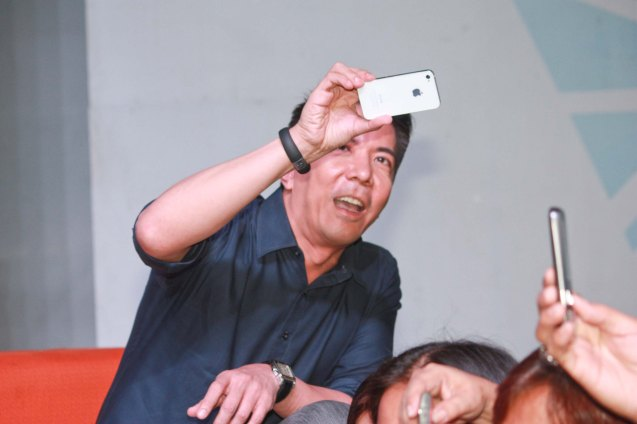 Executive Producer Melvin M. Mangada uses his i-phone 5 to shoot people shooting pics with their cellphones. Photo was taken during fan's day in SM North EDSA. Photo by Jude Bautista