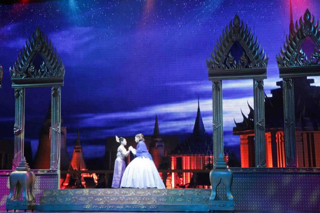 from left: Gina Respall (Lady Thiang) and Anna with night sky and Royal Palace exterior. KING AND I is extended at the New Port Performing Arts Theater in Resort's World Manila until May 2013. Photo by Jude Bautista