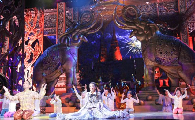 Fireworks shoot up the sky behind Nonie Buencamino (King Mongkut), Menchu Lauchengco-Yulo (Anna) and the children via the LED screen. KING AND I is extended at the New Port Performing Arts Theater in Resort's World Manila until May 2013. Photo by Jude Bautista