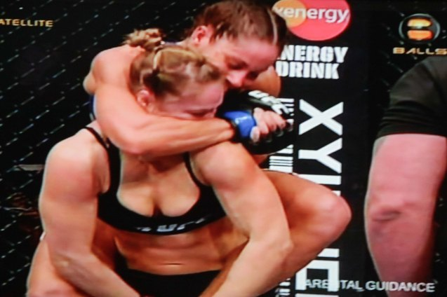 Carmouche had Rousey in trouble with a face crank. If she were able to put it under her chin it would be a rear naked choke. Uriah Faber was in the same position on Menjivar.