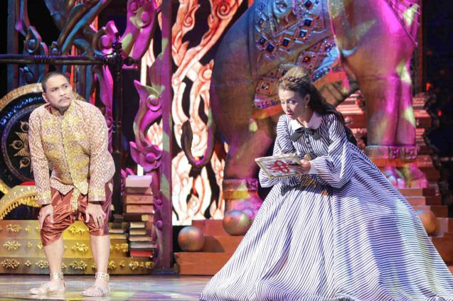 Menchu Lauchengco-Yulo (Anna) tries not to be higher than Nonie Buencamino (King Mongkut). KING AND I is extended at the New Port Performing Arts Theater in Resort's World Manila until May 2013. Photo by Jude Bautista