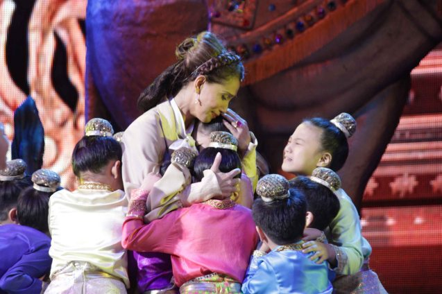 King's Children hugs Menchu Lauchengco-Yulo (Anna). KING AND I is extended at the New Port Performing Arts Theater in Resort's World Manila until May 2013. Photo by Jude Bautista