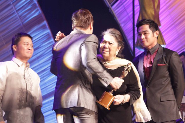 Butch Francisco receives the Dr. Jose Perez Memorial Award from left: FAMAS Pres. Angelo Padua, Marichu Vera Perez Maceda and Benjamin Alves. Photo was taken at the 61st FAMAS, April 21, 2013 AFP Theater. Photo by Jude Bautista