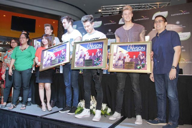 UNIVERSAL MCA Music Phils hands LAWSON their Gold record awards from left: Ad  & Promo Arlene Garcia, Domestic Label Mktg Mgr Mark Bonifacio,  Ad & Promo Karen Hernandez, Mktg Events Mgr Grace Foronda, Lead guitarist Joel Peat, vocalist Andy Brown, drummer Adam Pitts , bassist Ryan Fletcher and Mktg Mgr Wilson Cruz. Photo was taken during the press con at the Gallery Bar of Eastwood Richmonde Hotel April 8, 2013.