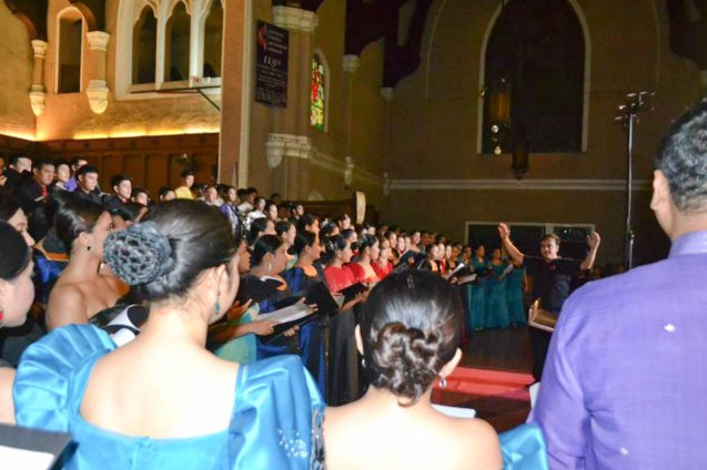 Kompositor President Joy Nilo conducts his original composition to all the performing choirs and audience. Contributed Photo.