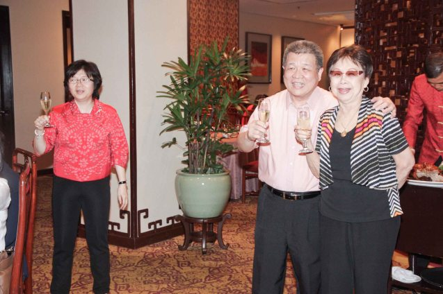 from left: Maggie Yum and Willie Tong toast Tita Lily at Summer Palace in EDSA Shangri La Hotel last December 9, 2012. Photo by Jude Bautista