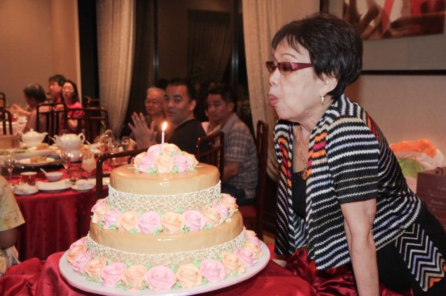 Tita Lily blows the candle on her cake at Summer Palace in EDSA Shangri La Hotel last December 9, 2012. Photo by Jude Bautista