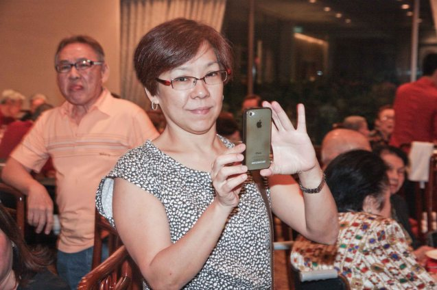 Anne Dorcy Cua of Citibank shoots with her i-phone 5 at Summer Palace in EDSA Shangri La Hotel last December 9, 2012. Photo by Jude Bautista