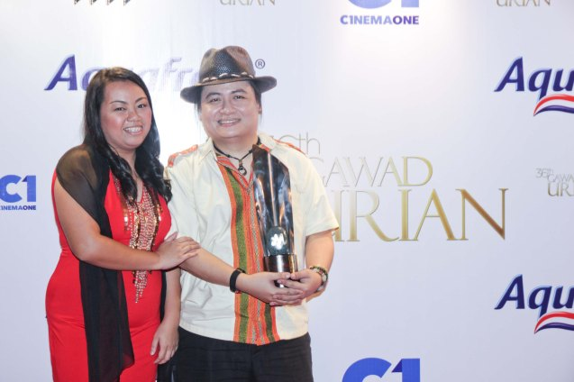 Best Music winner Diwa De Leon (BAYBAYIN) and wife Leonor Mae De Leon. Pic was taken during 36th URIAN awards night at the NBC tent last June 18, 2013. Photo by Jude Bautista