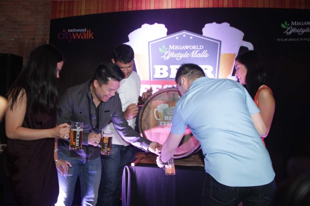 Megaworld First VP and Commercial Div. Head Kevin Tan taps the ceremonial beer keg at the Megaworld Lifestyle Malls' Beer Festival last September 26, 2013 at PUBLIKO Gastro Pub in Eastwood. The ceremony kicks off a month long celebration in all Megaworld Malls EASTWOOD City Mall and VENICE PIAZZA. Photo by Jude Bautista