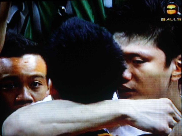 Jeron Teng hugs older brother Jeric Teng immediately after the game.