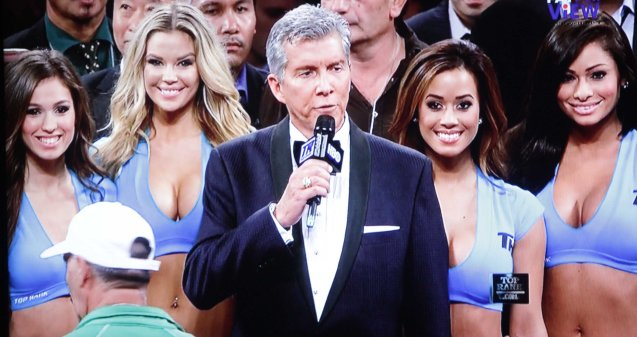 Michael Buffer is accompanied by hot TOP RANK Girls- The Knockouts