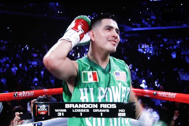 Brandon Rios is in high spirits in spite of boos from the crowd.