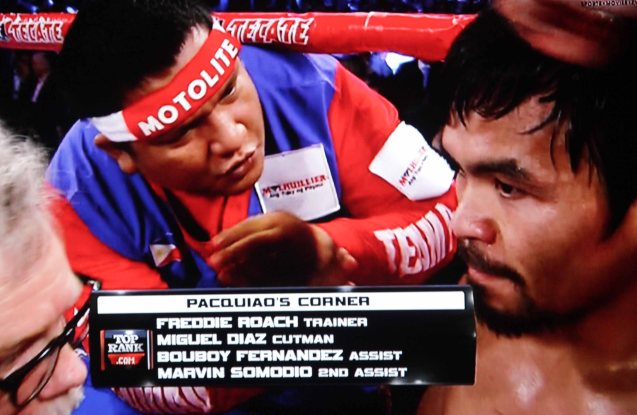 Asst Trainer Buboy Fernandez repeats Roach's instructions in Filipino at Pacquiao's corner.