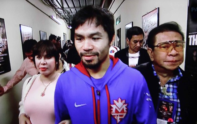 from right: Gov Chavit Singson, Manny Pacquiao and wife Jingkee arrive at the Cotai Arena.