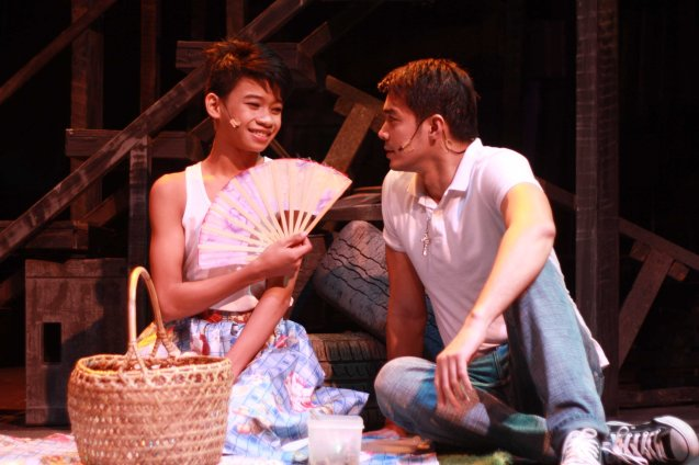 from left: Maxie (Jayvhot Galang)  and Victor (Jojo Riguerra) go on a picnic. Catch MAXIE THE MUSICAL from Nov 9-Dec 8, 2013 at the PETA Theater Center. Photo By Jude Bautista