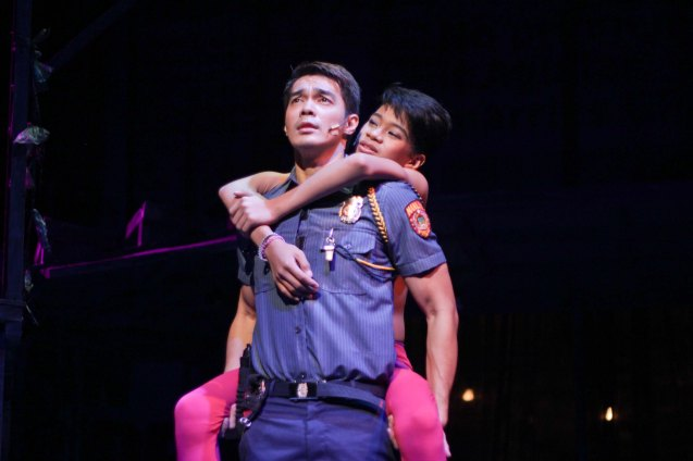 Maxie (Jayvhot Galang) is rescued by Victor (Jojo Riguerra) and meet for the first time. Catch MAXIE THE MUSICAL at from Nov 9-Dec 8, 2013 at the PETA Theater Center. Photo By Jude Bautista