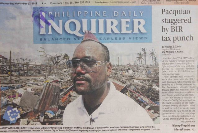 CAPTION FROM PDI: ARTIST WITH A BIG HEART Fil-Am singer and songwriter apl.de.ap of the Black Eyed Peas feels the pain of those who lost loved ones, homes and livelihoods as he surveys the damage wrought by typhoon Yolanda in Tacloban City. INQ Snap this page (not just the logo) to view more photos and access SONGS FROM THE PHILIPPINES. Photo by Raffy Lerma