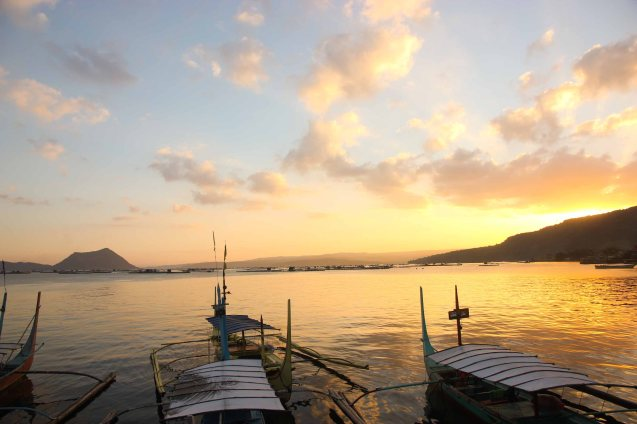 As we disembarked our boat the sunset was spectacular. That's Taal volcano's peaks (left). Photo by Jude Bautista