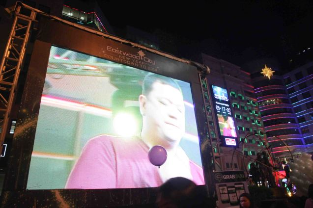 Mitoy Yonting THE VOICE winner is on the wide screen. It was put up so more people can watch performers on stage at the Eastwood City New Year Countdown to 2014, December 31 at the Eastwood Mall Open Park. Photo by Jude Bautista