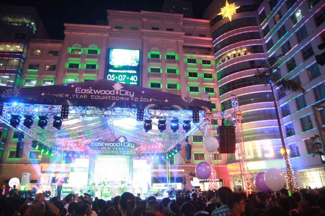 Right hand corner is the Dazzling Star that drops just like the ball in Times Square. Photo taken at the Eastwood City New Year Countdown to 2014, December 31 at the Eastwood Mall Open Park. Photo by Jude Bautista