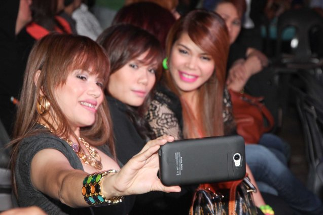 AEGIS selfie from left: Mercy, Juliet and Ken Sunot. RAK OF AEGIS is a musical based on the hits of 90's band AEGIS. It will run from January 31 to March 9, 2014 at the PETA Theater Center. Photo by Jude Bautista