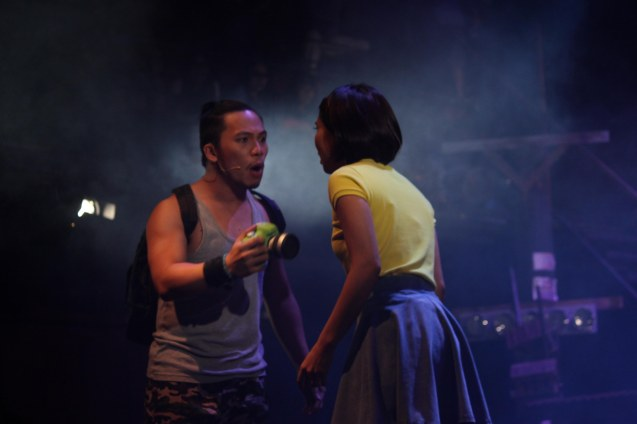 Poppert Bernadas (Kenny) woos Aicelle Santos (Aileen) with his digital camera. RAK OF AEGIS is a musical based on the hits of 90's band AEGIS. It will run from January 31 to March 9, 2014 at the PETA Theater Center. Photo by Jude Bautista