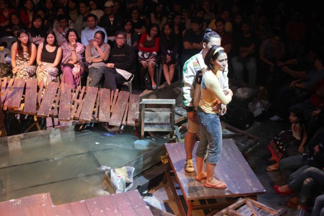 Poppert Bernadas (Kenny) and Aicelle Santos (Aileen) sing above flooded waters. RAK OF AEGIS is a musical based on the hits of 90's band AEGIS. It will run from January 31 to March 9, 2014 at the PETA Theater Center. Photo by Jude Bautista