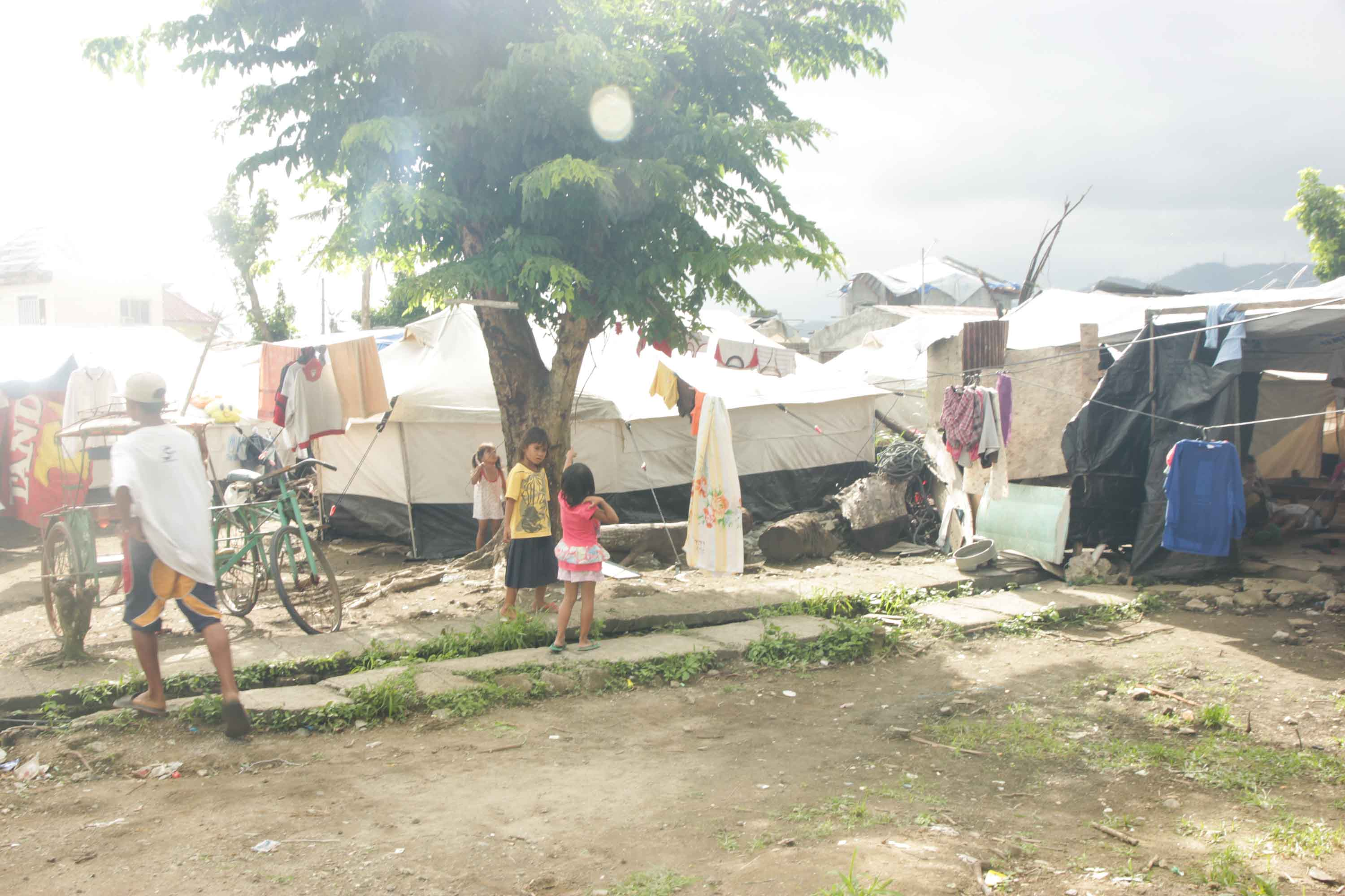 More than 100 days later people still live in tents in Tacloban. Photo taken & Education Is Key to Recovery | Text and Photos by Jude Bautista