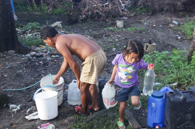 This is how most people collect their water, if and when they have access to it. Photo taken last February 10, 2014 in Tacloban, Leyte by Jude Bautista.
