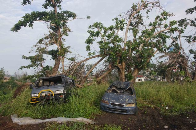 Vehicles were tossed by floods during Yolanda, just a few meters away from the airport. Photo taken last February 10, 2014 in Tacloban, Leyte by Jude Bautista.