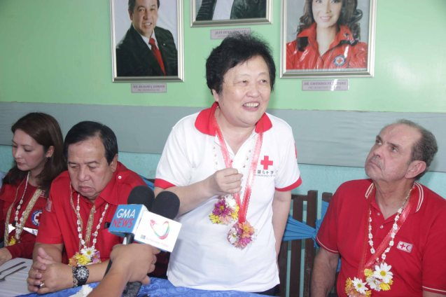 Red Cross (China) EVP & Intl Red Cross VP Dr. Baige Zhao credits the cooperation with Phil Red Cross as crucial to getting classrooms done quickly. Photo taken last February 10, 2014 in Tacloban, Leyte by Jude Bautista.