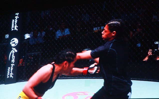 Julaton lands vicious left hook on Saber's body. The historic fight was during ONE FC: Rise of Heroes at the Mall of Asia Arena last May 2, 2014. Photo is from screen grab of ONE FC video.