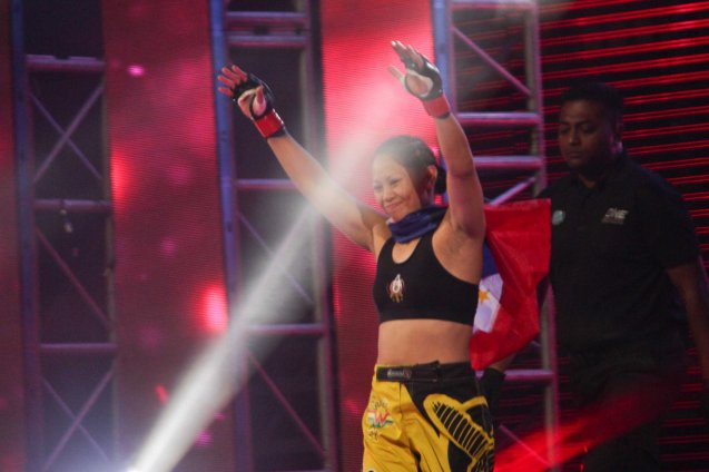 Our very own Super Pinay Ana the Hurricane Julaton makes a successful ONE FC debut w TKO victory over Egyptian Aya-Saeid Saber. The historic fight was during ONE FC: Rise of Heroes at the Mall of Asia Arena last May 2, 2014. Photo is from screen grab of ONE FC video.