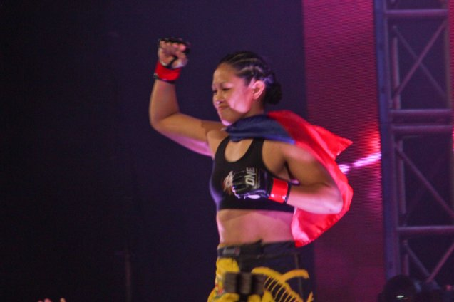 Our very own Super Pinay Ana the Hurricane Julaton makes a successful ONE FC debut w TKO victory over Egyptian Aya-Saeid Saber. The historic fight was during ONE FC: Rise of Heroes at the Mall of Asia Arena last May 2, 2014. Photo by Jude Bautista