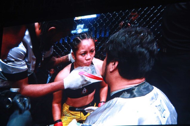 Angelo Reyes is the long time trainer of Ana 'The Hurricane' Julaton instructing her in the corner. The historic fight was during ONE FC: Rise of Heroes at the Mall of Asia Arena last May 2, 2014. Photo is from screen grab of ONE FC video.