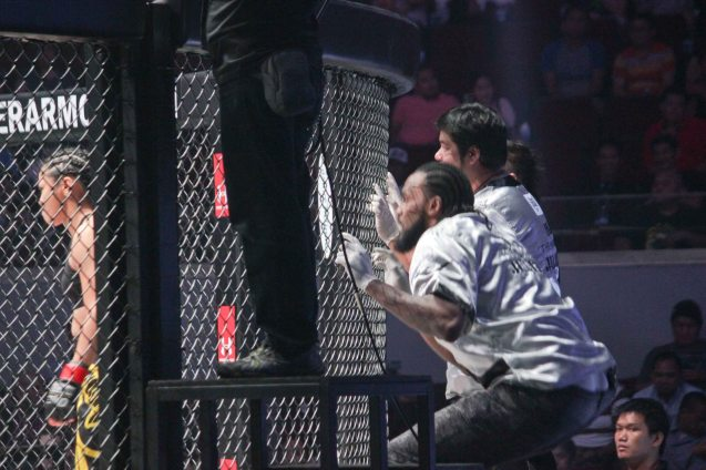 right: former Miami HEAT center Ronnie Turiaf in the corner of Ana the Hurricane Julaton. The historic fight was during ONE FC: Rise of Heroes at the Mall of Asia Arena last May 2, 2014. Photo by Jude Bautista