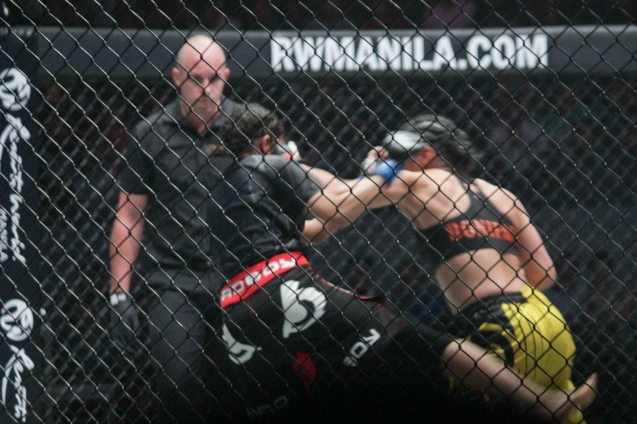 Ana the Hurricane Julaton lands left hook on Saber during ONE FC: Rise of Heroes at the Mall of Asia Arena last May 2, 2014. Photo by Jude Bautista