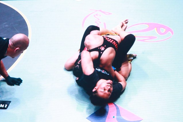 Aya-Saeid Saber locks in a lethal guillotine on Ana Julaton right on top of RWM logo. The historic fight was during ONE FC: Rise of Heroes at the Mall of Asia Arena last May 2, 2014