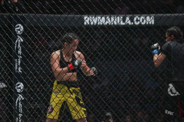 Ana Julaton had the heavier hands prompting Aya-Saeid Saber to shot for the takedowns. The historic fight was during ONE FC: Rise of Heroes at the Mall of Asia Arena last May 2, 2014. Photo by Jude Bautista