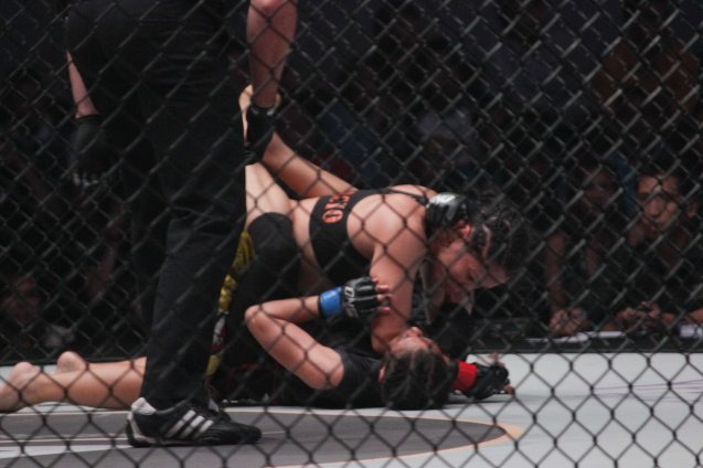 Julaton landed vicious ground and pound on Saber during ONE FC: Rise of Heroes at the Mall of Asia Arena last May 2, 2014. Photo by Jude Bautista