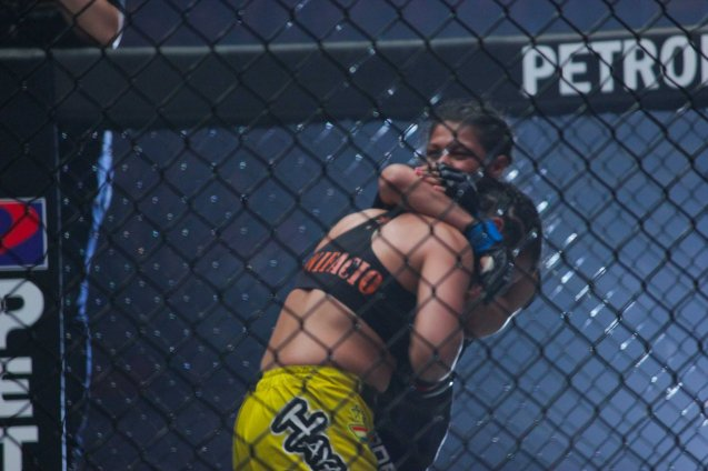 Julaton pushes Saber against the fence. The historic fight was during ONE FC: Rise of Heroes at the Mall of Asia Arena last May 2, 2014. Photo by Jude Bautista.
