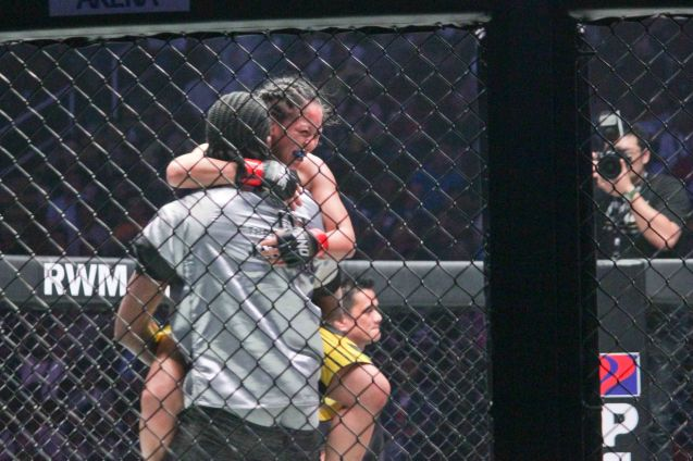 former MIAMAI HEAT Center Ronnie Turiaf lifts Anna Julaton in victory. The historic fight was during ONE FC: Rise of Heroes at the Mall of Asia Arena last May 2, 2014. Photo by Jude Bautista