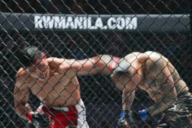 Left: Ed Folayang lands vicious left hook on the durable Boku. The fight was during ONE FC: Rise of Heroes at the Mall of Asia Arena last May 2, 2014. Photo by Jude Bautista